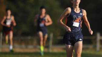 Aidan Caggiano of Manhasset legs out a win