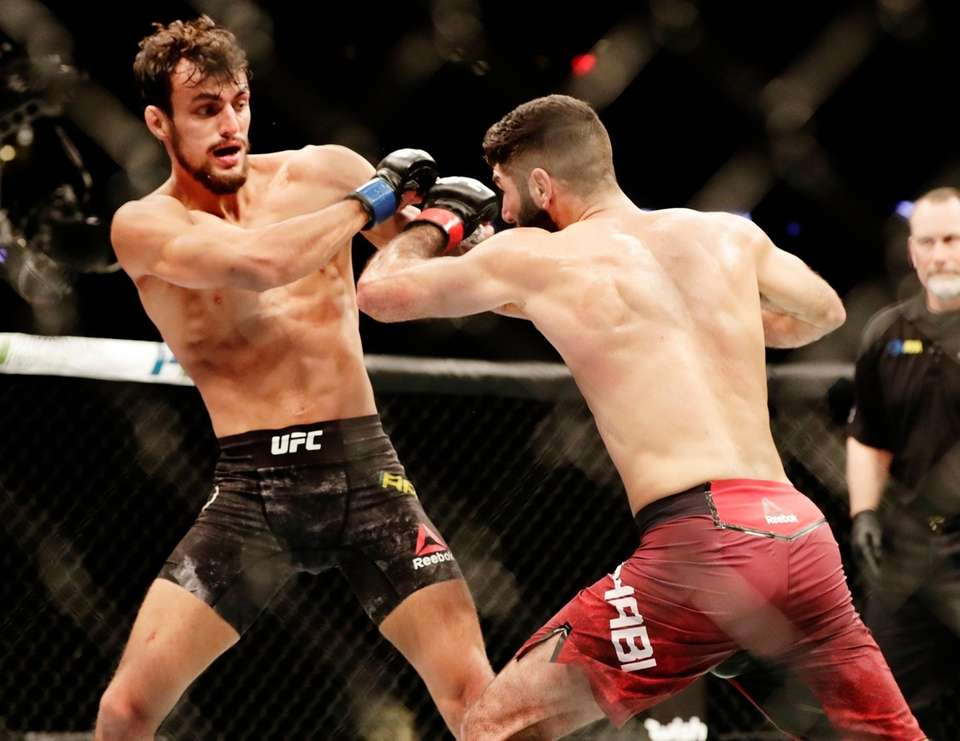 Ricardo Ramos, left, of Brazil, fights Aiemann Zahabi,