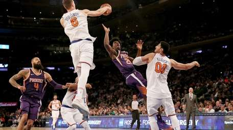 Kristaps Porzingis of the New York Knicks blocks