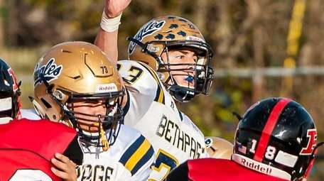 Bethpage quarterback Jason Seiter passes the ball during