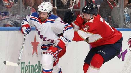 The Rangers' David Desharnaisis pursued by the Panthers'Ian