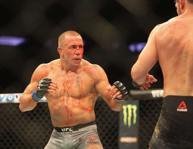 Georges St-Pierre defeated Michael Bisping to win the
