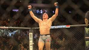 Georges St-Pierre celebrates beating Michael Bisping via third-round