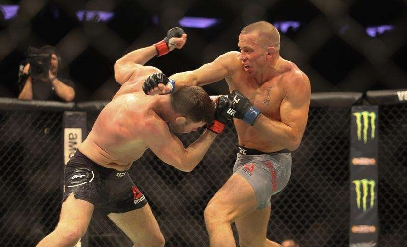 Georges St-Pierre beat Michael Bisping via third-round submission