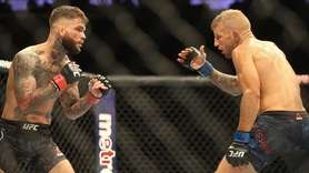 Cody Garbrandt, left, and TJ Dillashaw fight for
