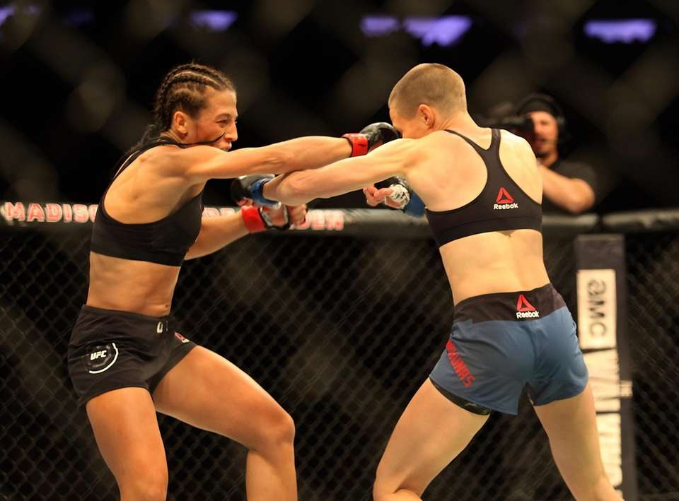 Rose Namajunas (blue shorts) and Joanna Jedrzejczyk exchange
