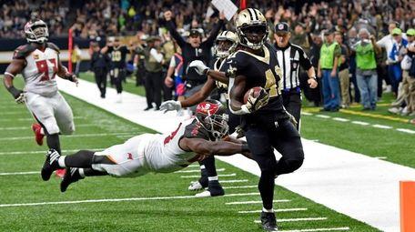New Orleans Saints running back Alvin Kamara carries