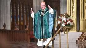 Cardinal Timothy Dolan appealed to parishioners to remember