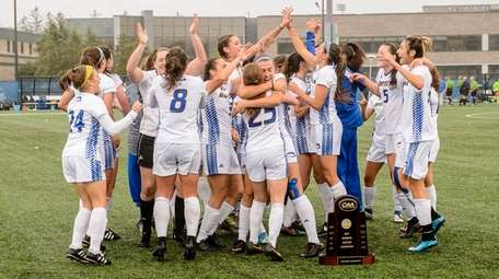 Hofstra celebrates its victory over Northeastern in the