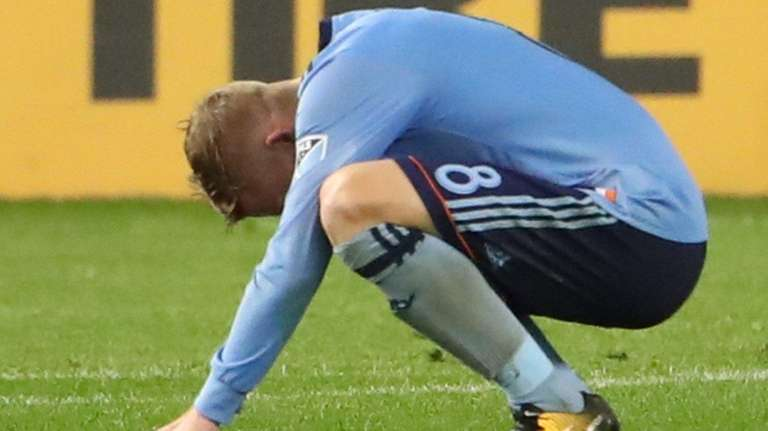 New York City FC midfielder Alexander Ringreacts afterbeing