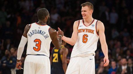 Knicks forward Kristaps Porzingiscelebrateswith Tim Hardaway Jr. in