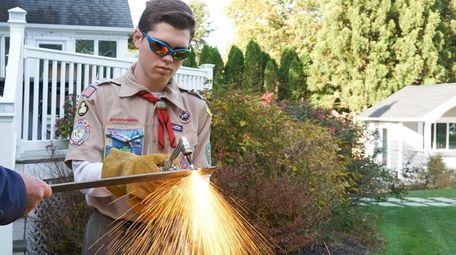 John Ninia demonstrates his welding skill at his