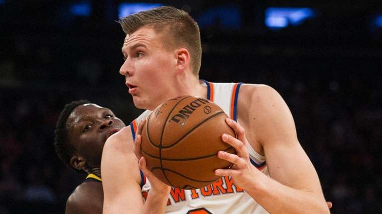 Pacers guard Victor Oladipo defends Knicks forward Kristaps