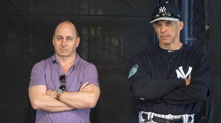 Yankees GM Brian Cashman watches a bullpen session