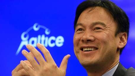 Altice USA CEO Dexter Goei holds a media