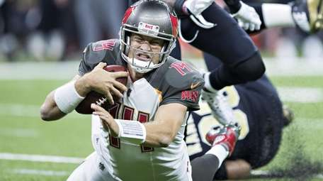 Ryan Fitzpatrick of the Buccaneers is tackled from