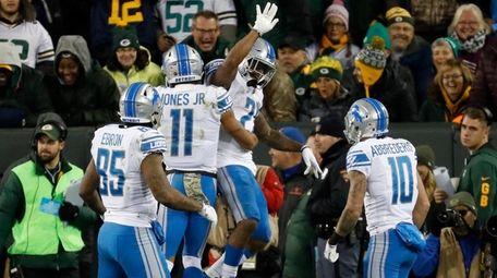 The Lions' Ameer Abdullah celebrates his touchdown run