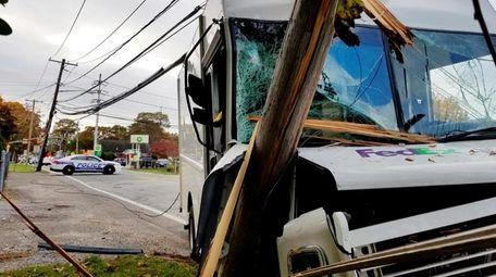 A FedEx truck struck a utility pole on