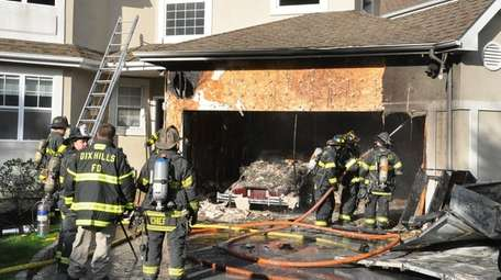 Dix Hills firefighters respond to a blaze at