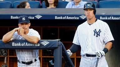 Aaron Judge and manager Joe Girardi of the
