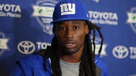 Giants cornerback Janoris Jenkins (20) speaks with the