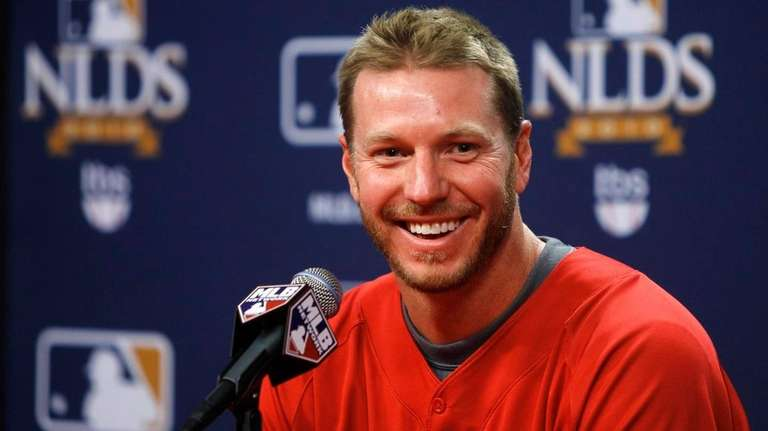 Phillies pitcher Roy Halladay laughs after answering a