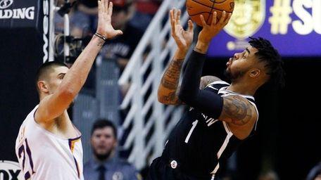 Nets guard D'Angelo Russell shoots as Suns center