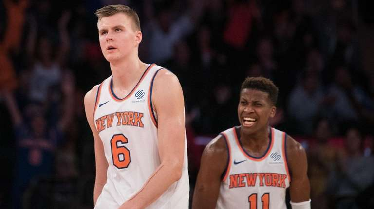 Knicks guard Frank Ntilikina celebrates forward Kristaps Porzingis' basket