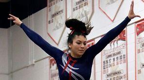 Smithtown's Brittney Viera performs on the balance beam