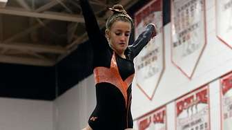 Babylon's Bella Kelly perfoms on the balance beam
