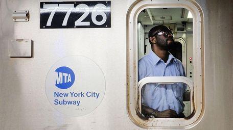 A Metropolitan Transportation Authority subway conductor prepares to