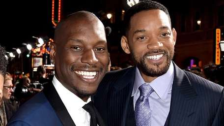 Actors Tyrese Gibson, left, and Will Smith in