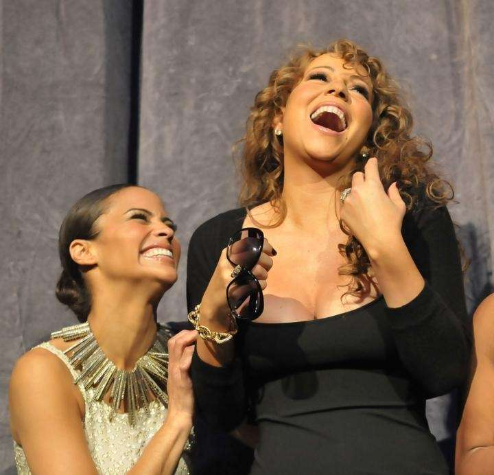 Actress Paula Patton and singer/actress Mariah Carey onstage