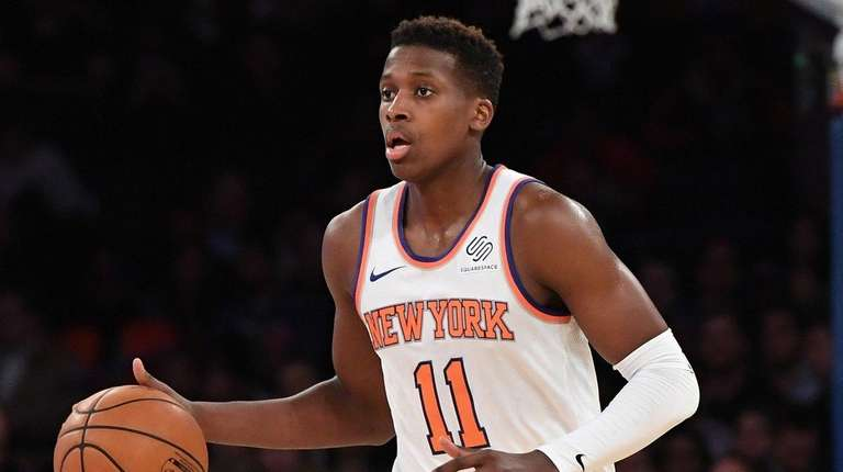 Knicks guard Frank Ntilikina brings the ball up