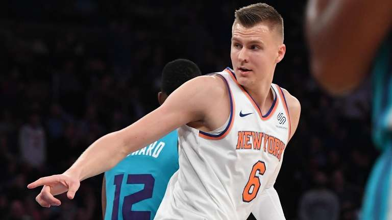 Knicks forward Kristaps Porzingis reacts after he dunks