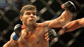 Paulo Costa, left, and Johny Hendricks during a