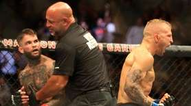 TJ Dillashaw, right, celebrates after referee Dan Miragliotta