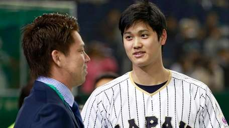 Japan pitcher Shohei Ohtanii, right, chats with Los