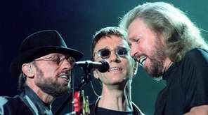 The Bee Gees -- brothers Maurice, Robin