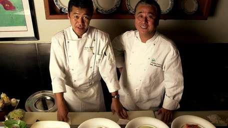Chef Nobu Matsuhisa, right, poses with plates and