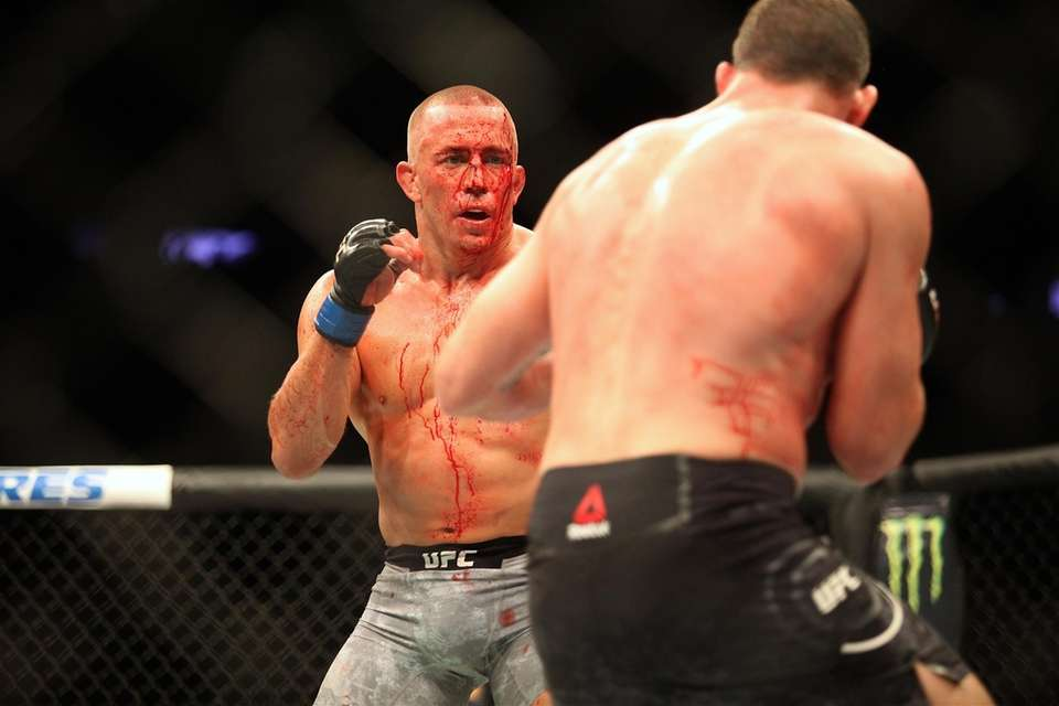 A bloodied Georges St-Pierre fights on against Michael