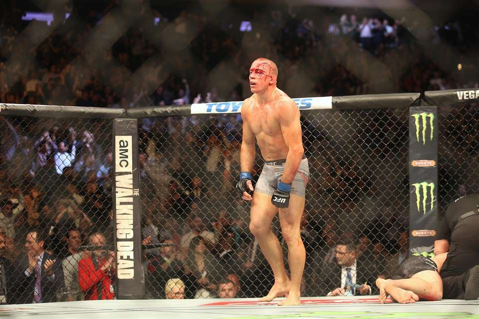 Georges St-Pierre submitted Michael Bisping in the middleweight