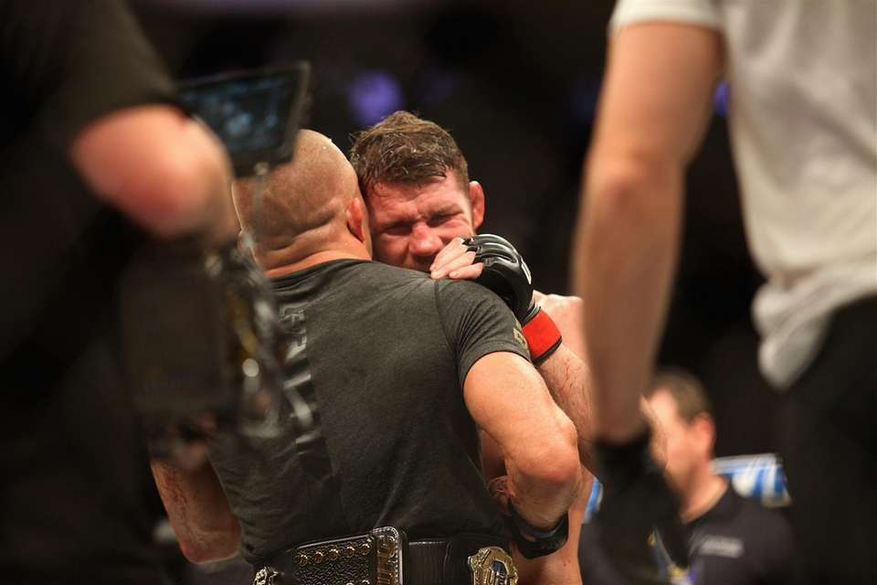Michael Bisping congratulates Georges St-Pierre on his victory