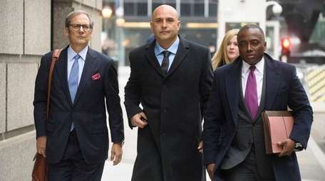 Craig Carton, center, arrives at a federal courthouse