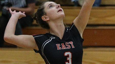 Melissa Loyer of East Rockaway plays the ball