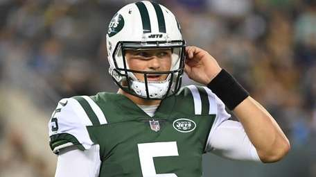 Jets quarterback Christian Hackenberg looks on from the