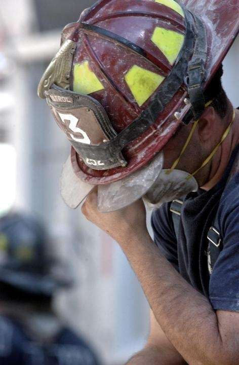 A firefighter is seen in the wreckage of