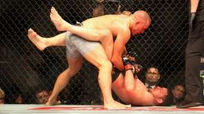 Georges St-Pierre sets up his finishing sequence against