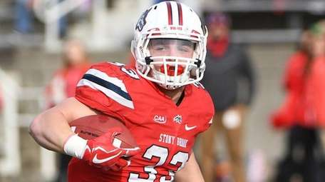 Stony Brook running back Donald Liotine  against Albany at