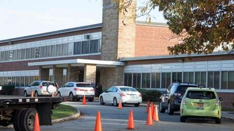 Parents drop off their children at Woodland Elementary